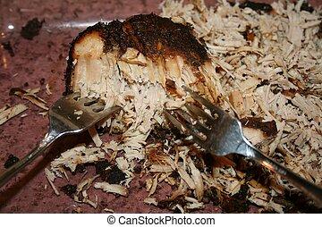 Pork BBQ close up: fork shredding