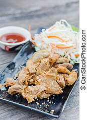 pork chitterlings fried served with chili sauce