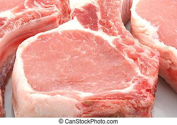 three pork chops close up
