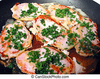"Pork chops cooking. ""Cooking dinner\"" series. - Pork chops..."