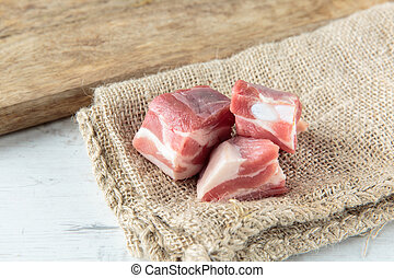 Pork chops - Fresh raw pork chops on a jute cloth