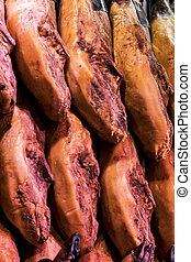 Pork ham background in the market for the sale of meat products.