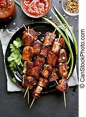 Pork kebabs on wooden skewers