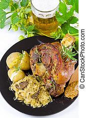 pork knuckle and beer - Roasted pork knuckle. Ham and bacon ...