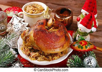 pork knuckle with sauerkraut for christmas dinner - roasted...