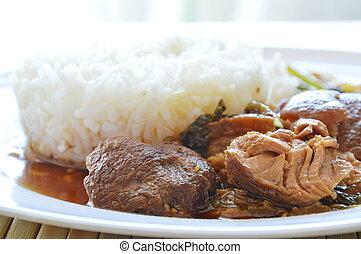 pork leg stewed with rice on plate