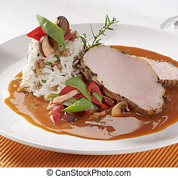 Pork loin with rice and sauce - Roast pork loin with rice ...