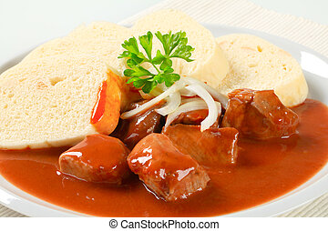 Pork meat in tomato sauce with dumplings - Pork meat in...