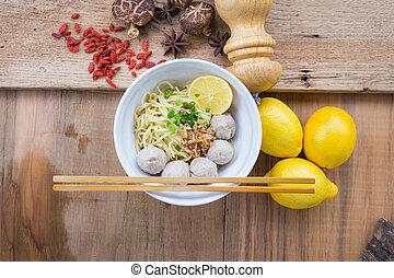 pork meatballs and noodle soup.