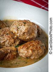 Pork meatballs with dill sauce. Selective focus.
