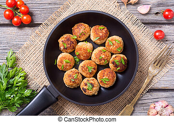 Pork meatballs with parsley in pan . Top view