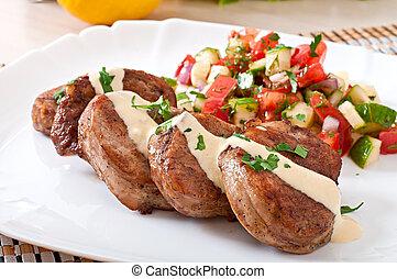 Pork medallions with salsa