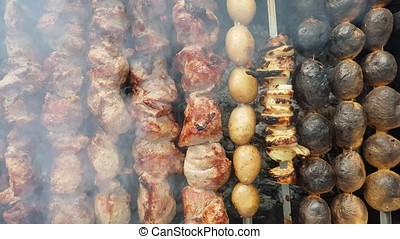 pork, onions and potatoes skewers on bbq