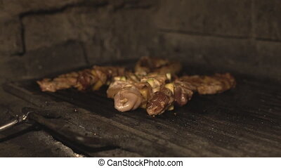 Pork or beef meat and chicken fillet are cooked on the...
