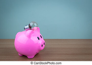 Pork piggy bank with a light bulb