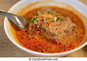 pork rib boiled in tomyum soup
