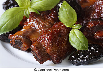 Pork ribs stewed with prunes macro. horizontal top view -...