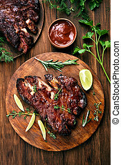 Pork ribs, top view - Grilled pork ribs, tomato sauce and...