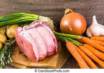Pork roast - Organic pork lion roast with rosemary on wood ...