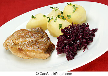 Pork roast with potatoes and red cabbage