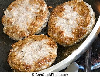 pork sausage patties - pork sausage patties cooking in...