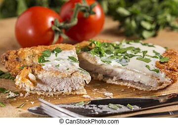 Pork schnitzel with white sauce and parsley