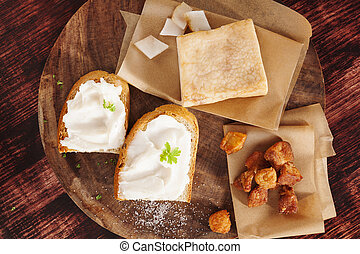 Pork scratchings, bacon and bread with lard spread. - Pork ...