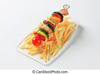 Pork skewer and French fries