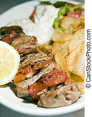 pork souvlaki with tzatziki taverna food Greece