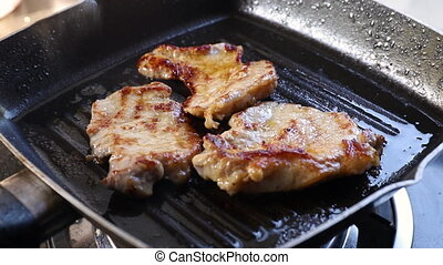 steak - Pork steak on barbecue grill