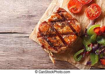 pork steak with vegetables close-up  horizontal top view, rustic