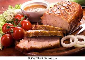 pork - Close-up of a roast tenderloin pork served with...