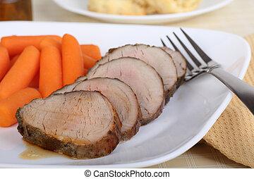 Pork Tenderloin Meal - Sliced pork tenderloin with carrots...