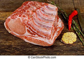 Pork tenderloin on ribs with garlic.