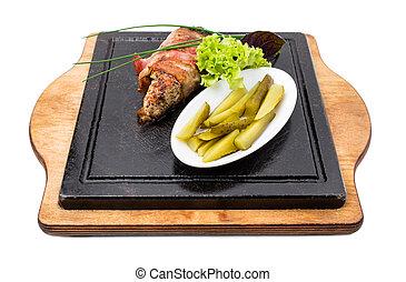 Pork tenderloin stuffed with herbs and garlic.