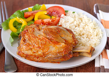 pork with rice and salad on plate
