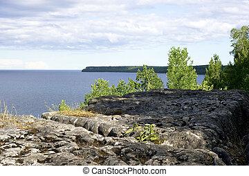 Porous rock ledge looking out at lake Georgian bay - Porous ...