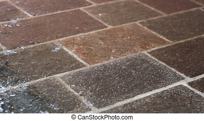 Porphyry floor in the rain - External floor in the rain....