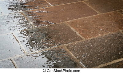 Porphyry floor in the rain