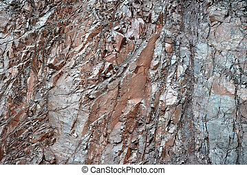 porphyry rock background in a quarry. natural texture.