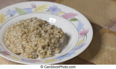 Porridge oats with water for breakfast as a healthy diet -...