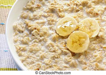 Porridge with banana and honey. Traditional Scottish oatmeal.