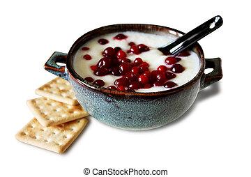 Porridge with cowberry in a ceramic bowl.