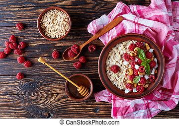 porridge with fresh raspberry and nuts