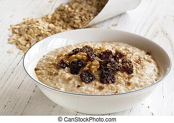 Porridge with walnuts, raisins and brown sugar. Delicious oatmeal.