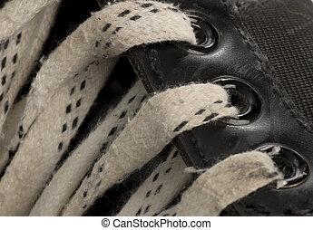 porté, patin, détails, paire, hockey, dentelles