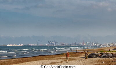 Port and beach time-lapse - Long shot of port with huge...