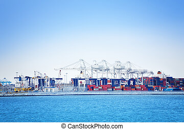 Port cranes and containers at maritime terminal
