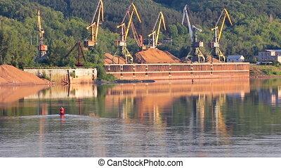 port cranes on river
