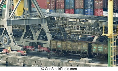 Port cranes unloads cars with coal timelapse